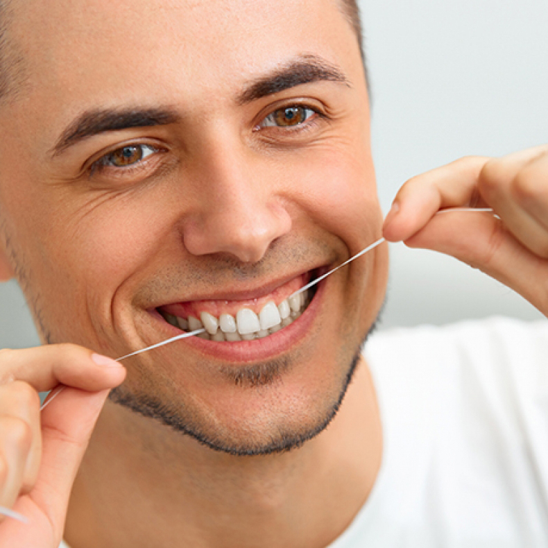 Generic-dentist_SMM_man-flossing_20180406.jpg